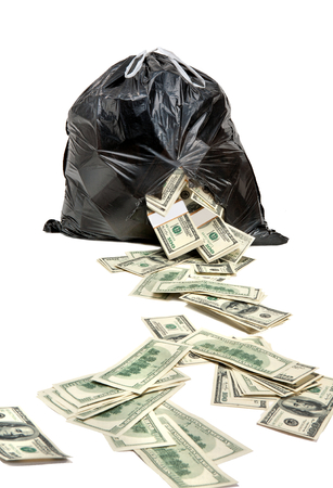 evidence bag: There s Money in Rubbish - studio photography of black plastic bag with hundred dollar bills on a white background Stock Photo