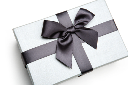 giftboxes: Packaging gift box - studio photography of black and white box wrapping ribbon with bowknot - on white background Stock Photo