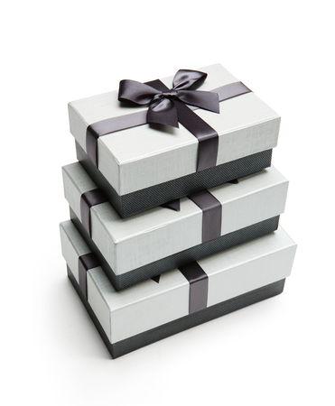 black ribbon bow: Gift packaging boxes - studio photography of black and white box wrapping ribbon with bowknot - on white background Stock Photo