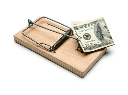hypothec: Activated mousetrap with money  Hypothec - studio photography of one hundred dollar bill and mousetrap on a white background