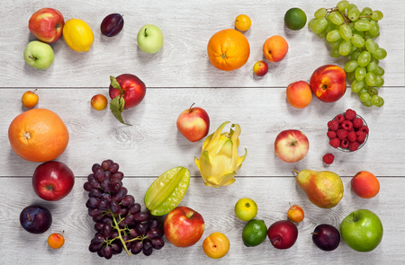 detoxification: Healthy eating background - studio photography of different fruits and vegetables on wooden table