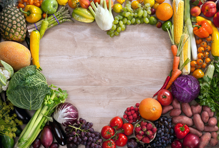 Heart shaped food - food photography of heart made from different fruits and vegetables on wooden table Archivio Fotografico