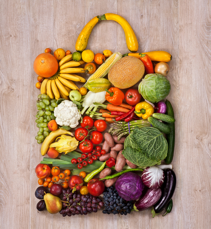 food photography: Healthy food shopping - food photography of designer handbag made from different fruits and vegetables on wooden table