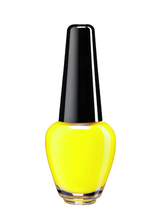 Vibrant colourful yellow nail varnish  - studio photography of nail polish bottle with black lacquer cap over white background