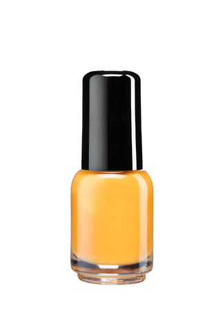 Orange nail varnish - studio photography of nail polish bottle with black lacquer cap over white background