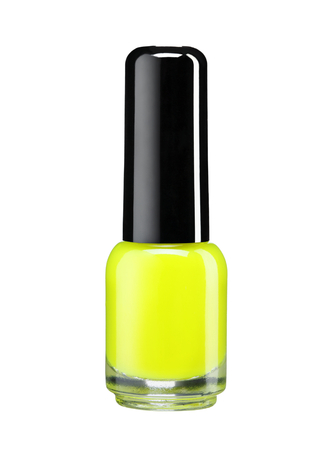 Yellow nail varnish - studio photography of nail polish bottle with black lacquer cap over white background