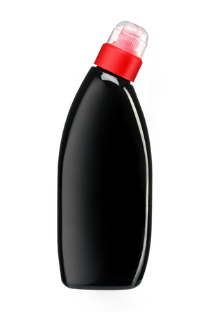household objects equipment: Toilet cleaner bottle with red cap - studio photography of black plastic bottle - isolated on white background Stock Photo