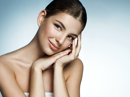 Latina girl with pretty smiling face. Woman skin care concept photo