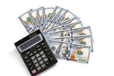 Financial calculator and US money - studio photography of USD and a small electronic device with a keyboard and a visual display photo