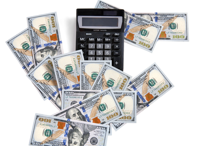 Modern electronic calculator and paper money - studio photography of USD and a small electronic device with a keyboard and a visual display photo