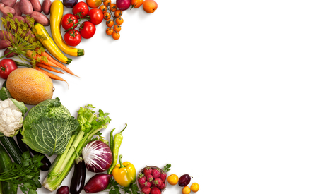 Healthy food background - studio photo of different fruits and vegetables on white backdrop