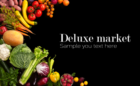 organic background: Deluxe market - studio photo of different fruits and vegetables on black backdrop