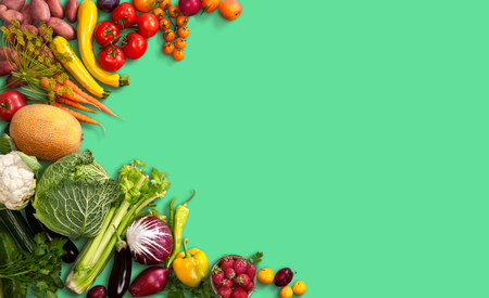 healthy product: Super-food background - studio photo of different fruits and vegetables on green backdrop