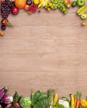 greens: Healthy food background - studio photography of different fruits and vegetables on wooden table Stock Photo