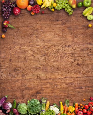 fresh vegetable: Healthy food background - studio photography of different fruits and vegetables on old wooden table