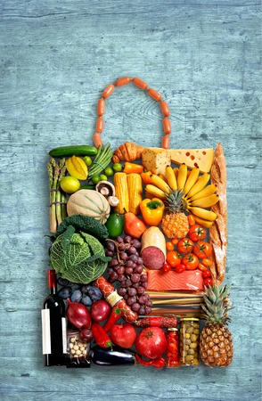 food photo of handbag made from different fruits and vegetables on wooden table photo