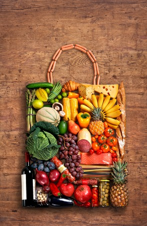food photography of handbag made from different fruits and vegetables on old wooden table photo
