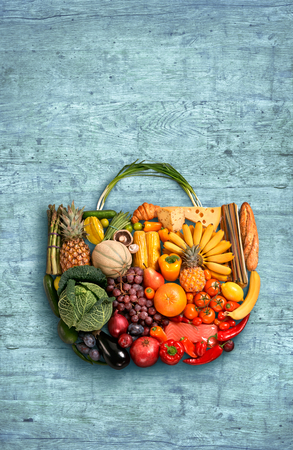 food photography: food photography of designer handbag made from different fruits and vegetables on wooden table Stock Photo