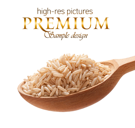 Unpolished rice in a wooden spoon - cereal on wooden spoons isolated on white background with place for your text photo