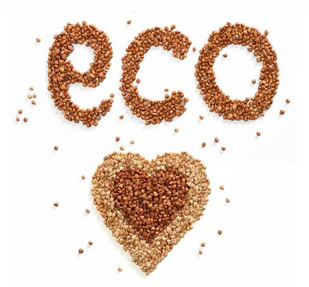 groat: Word eco and Heart symbol composed of premium buckwheat groats on white background
