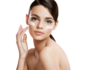 glowing skin: Skin care woman putting face cream