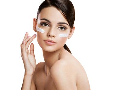 moisturizer: Skin care woman putting face cream