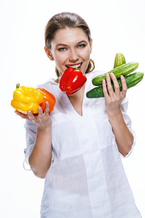 sparingly: Cheerful young woman of the European appearance promotes a healthy lifestyle by eating health food Stock Photo