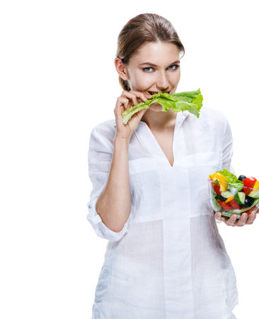 sparingly: Healthy lifestyle woman eating salad smiling happy, healthy food concept