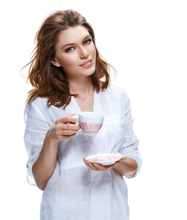 derive: Beautiful woman holding a cup of coffee and saucer Stock Photo