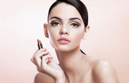 pomatum: Charming young babe with lipstick Stock Photo