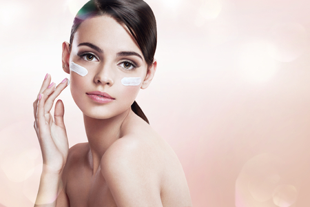 beautiful skin: Skin care teenage girl putting face cream