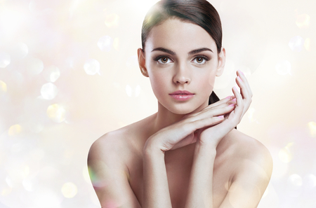 health conscious: Charming young lady with perfect makeup, skin care concept