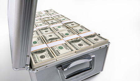 studio photography of silver case with hundred dollar bills on a white background photo