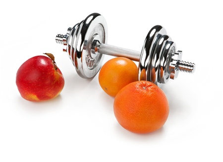 Red apple, orange citrus and dumbbell photo