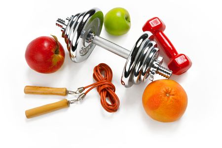 fat burning: Sporty still life - photo of weight training and fitness equipment on white background