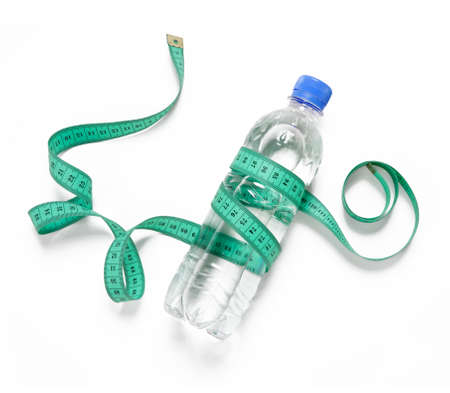fat burning: Bottled water for healthy life over a white background