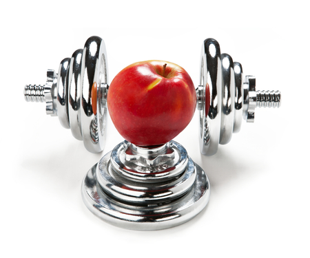 chromium plated: One apple and dumbbell Stock Photo