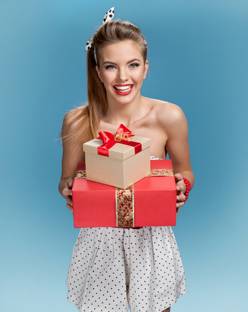 hair wrapped up: Happy woman with a gift Stock Photo
