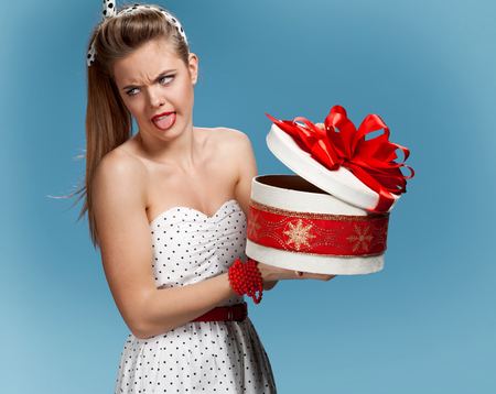 hair wrapped up: Disappointed woman with a gift box