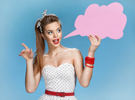 talkative: Gabby woman showing sign speech bubble banner looking happy excited Stock Photo