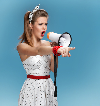 directors cut: Sexy pin-up girl holding a mouthpiece, speaking trumpet. Filmmaking or film production concept