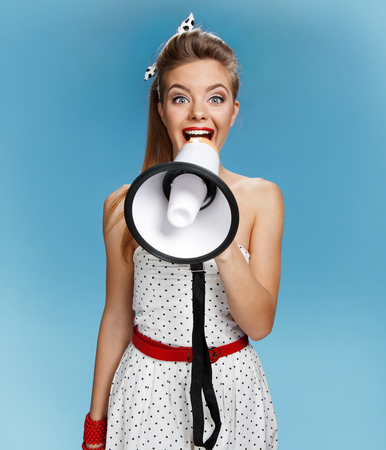 filmmaking: pin-up girl holding a mouthpiece, speaking trumpet. Filmmaking or film production concept Stock Photo