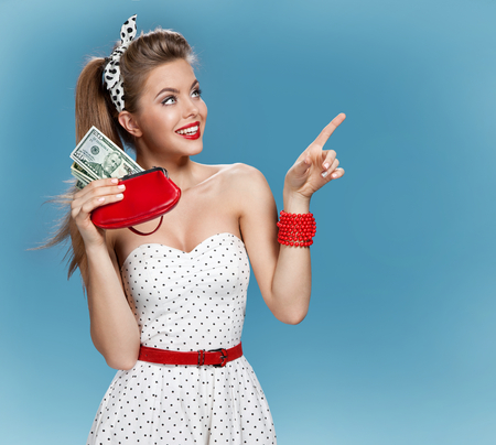 Thrilled young lady holding cash and happy smiling. Shopping concept Stok Fotoğraf