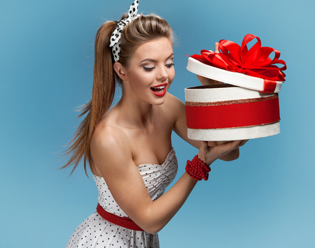 gift packs: Young happy excited woman open gift box. Holidays, holiday, celebration, birthday and happiness concept