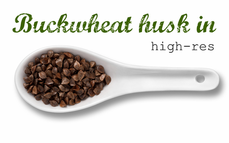 husk: Husk buckwheat in white porcelain spoon  high resolution product photography of seed in white porcelain spoon over white background with place for your text Stock Photo