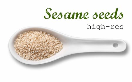 white sesame seeds: White sesame seeds in a wooden spoon  high resolution product photography of seed in white porcelain spoon over white background with place for your text