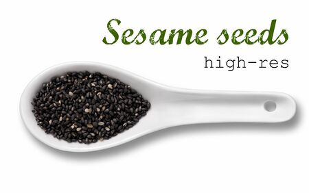 sesame seeds: Black sesame seeds in a wooden spoon  high resolution product photography of seed in white porcelain spoon over white background with place for your text Stock Photo