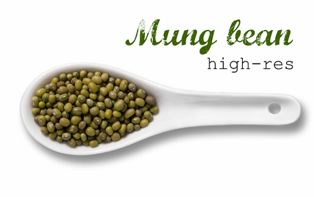 Mung beans in a wooden spoon  high resolution product photography of seed in white porcelain spoon over white background with place for your text photo