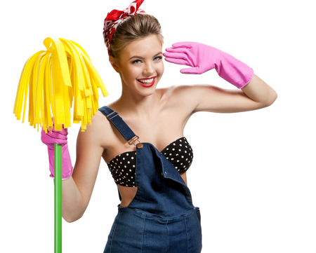 Beautiful cleaninig lady wearing pink rubber protective gloves holding cleaning mop / young beautiful American pin-up girl isolated on white background. Cleaning service concept