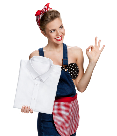 laundered: Happy housewife holding mens laundered shirt in purest white and showing us it
